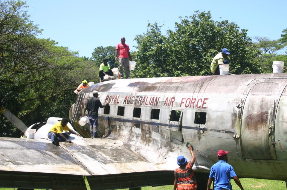 Above: Gala Ice Cream employees washing off years of dirt and grit from the RAAF DC-3 plane on Saturday 10th October.