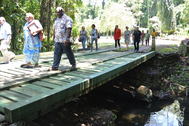 Above: Guests take a tour through the gardens, seen here walking over the newly built bridge with materials donated by PNG Forest Products and Swire Shipping and construction undertaken by Dekenai Constructions.